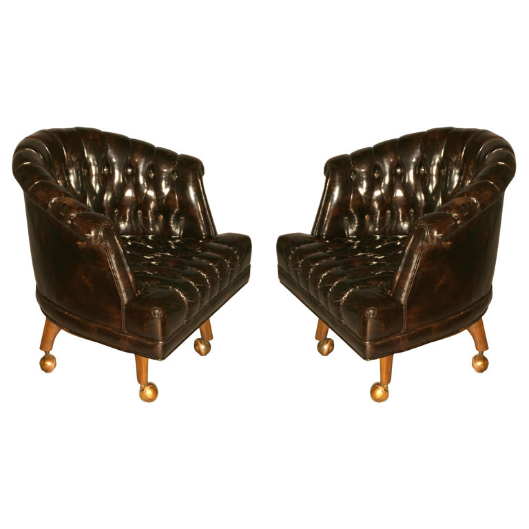 Charming Leather Appears Black, Yet Bright Light Reveals A Very Dark Brown Color  With Some Deep Red. Heavy, Solidly Built Chair On A Mahogany Base That  Swivels.